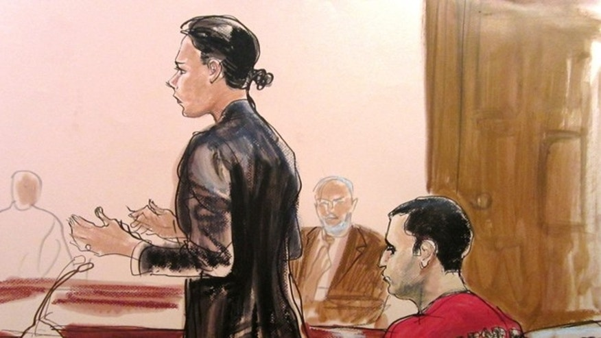 Oct. 25, 2012: In this courtroom drawing Federal Defender Julie Gatto requests bail for her client, New York City Police Officer Gilberto Valle, right, at Manhattan Federal Court in New York.