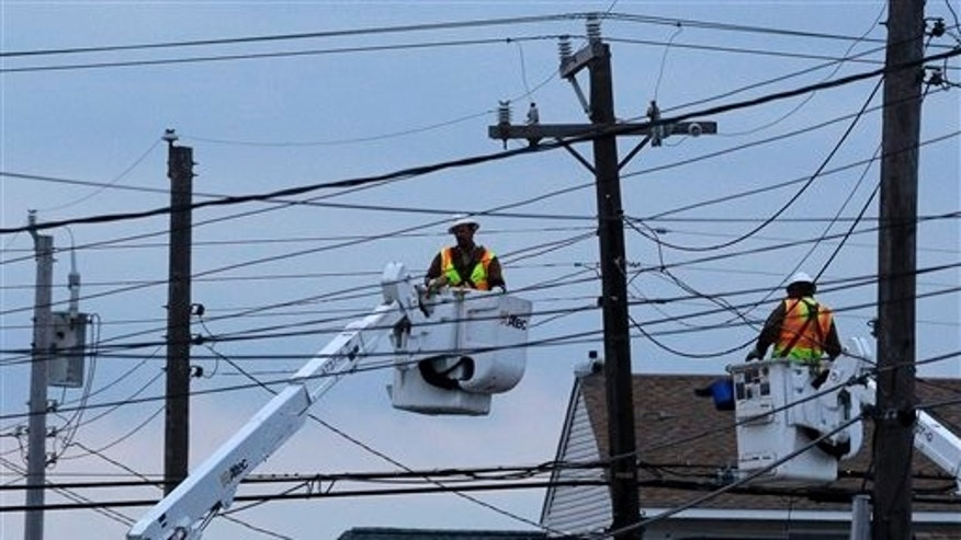 Utility crews work on power lines in response to superstorm Sandy as dusk falls in Ship Bottom, a community on Long Beach Island, N.J., Thursday, Nov. 1, 2012. Superstorm Sandy has left parts of New Jersey's beloved shore in tatters, sweeping away beaches, homes and amusement parks. The devastation leaves the state a blank canvas to redevelop. But environmentalists and shoreline planners are now urging the state to think about how — and if — to redevelop the shoreline. (AP Photo/Patrick Semansky)