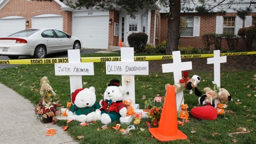 Nov. 1, 2012: A makeshift memorial is seen outside a home in Naperville, Ill., where two children were found stabbed to death on Oct. 30.