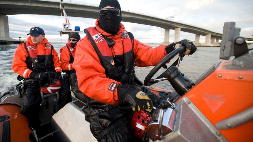 Nov. 3, 2012: Photo,  provided by the U.S. Coast Guard shows a small-boat crew performing a law enforcement patrol near Sandy Hook, N.J. The Coast Guard crew has uncovered several navigation hazards during the agency's first patrol of Sandy Hook waterways since Superstorm Sandy hit the region a week ago.