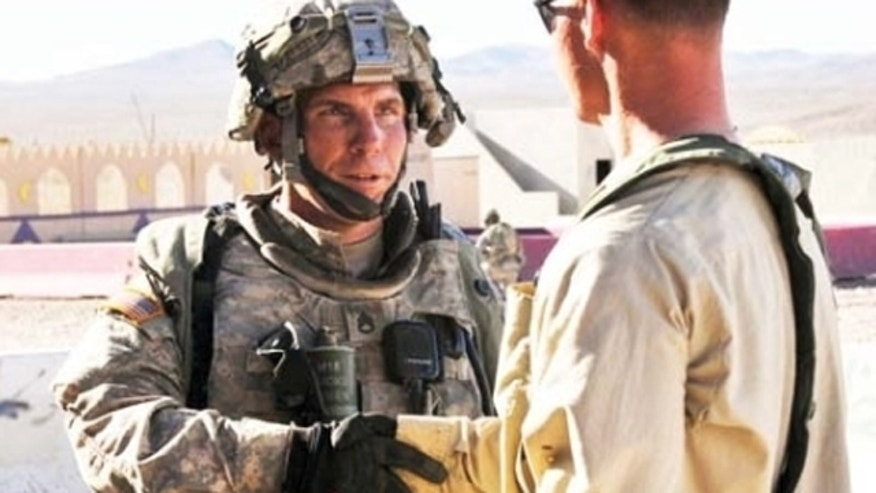 Aug. 23, 2011: Staff Sgt. Robert Bales is seen in this image from a military newsletter participating in a training exercise meant to simulate contact with local Afghan civilians.