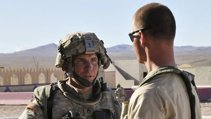 Aug. 23, 2011: In this file photo, Staff Sgt. Robert Bales, left, 1st platoon sergeant, Blackhorse Company, 2nd Battalion, 3rd Infantry Regiment, 3rd Stryker Brigade Combat Team, 2nd Infantry Division participates in an exercise at the National Training Center at Fort Irwin, Calif.