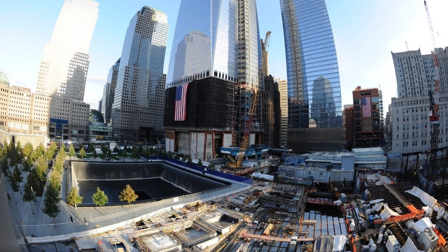 NEW YORK, NY - SEPTEMBER 11:  The North Pool of the 9/11 Memorial, with One World Trade Center under construction at rear during the tenth anniversary ceremonies of the September 11, 2001 terrorist attacks at the World Trade Center site, September 11, 2011 in New York City. New York City and the nation are commemorating the tenth anniversary of the terrorist attacks on lower Manhattan which resulted in the deaths of 2,753 people after two hijacked planes crashed into the World Trade Center.  (Photo by Robert Deutsch-Pool/Getty Images)