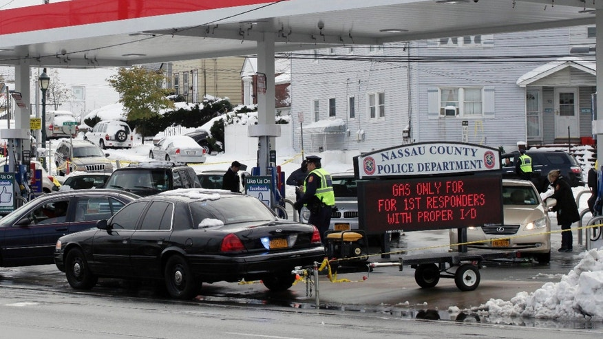 Nov. 8, 2012: Nassau County Police control access to an Exxon station in Elmont, N.Y. Gasoline supplies have been limited in the region since Superstorm Sandy hit ten days ago. The police are limiting sales of gasoline at this Long Island station to first responders.