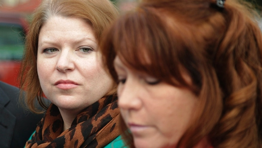Nov. 13, 2012: Kari Bales, left, listens as her sister, Stephanie Tandberg, right, reads a statement to reporters outside the building housing a military courtroom on Joint Base Lewis McChord in Washington state.