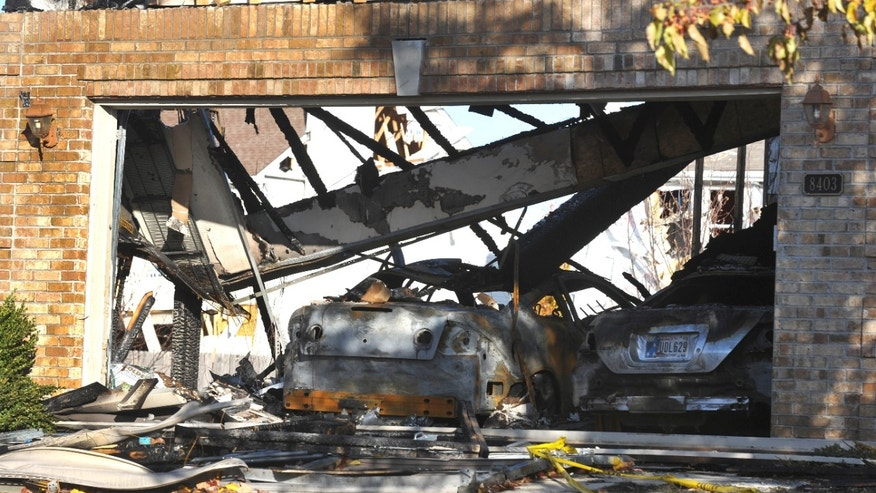 Nov. 12, 2012: Demolished vehicles sit in a destroyed attached garage at a home on Fieldfare Way in the Richmond Hills subdivision in Indianapolis.