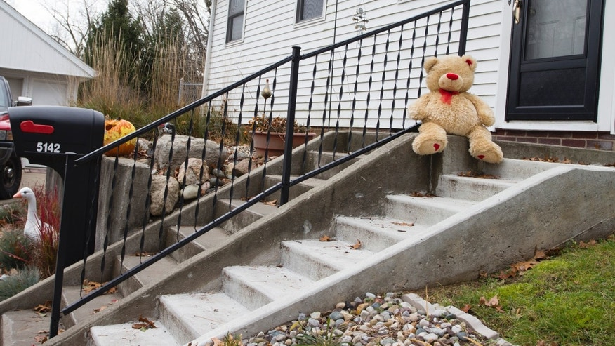 Nov. 13, 2012: A lone teddy bear sits on the steps of the home where three children, their uncle, and their grandmother were found dead inside a garage Monday in what appears to be a murder-suicide amid a custody dispute in Toledo, Ohio.