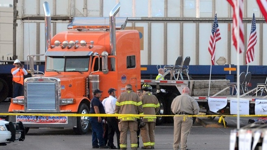 Nov. 15, 2012: Midland police, fire and sheriffs respond to an accident where a trailer carrying wounded veterans in a parade was struck by a train in Midland, Texas.