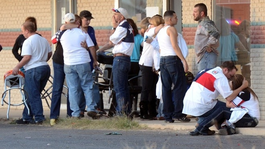 Nov. 15, 2012: Parade participants react after a trailer carrying wounded veterans in a parade was struck by a train in Midland, Texas.