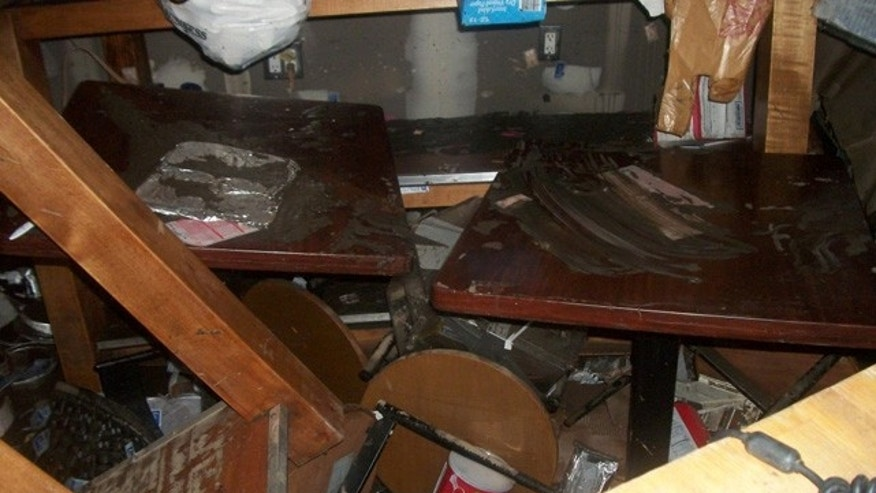 "Diana Petrone, who launched her ""Not Just Bagels"" business in 2004, has been living a nightmare since Sandy struck three weeks ago. This image shows the inside of Petrone's store after the storm."