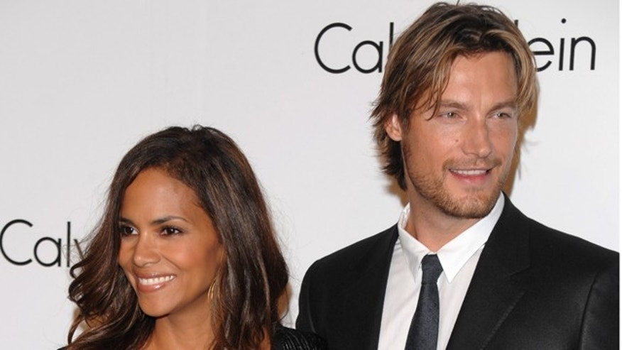 n this Sept. 7, 2008 file photo, Model Gabriel Aubry and actress Halle Berry attend a Fashion Week event in New York.