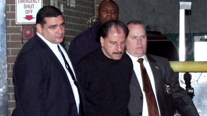 Nov. 21: Police escort Salvatore Perrone, center, from the 67th Precinct.