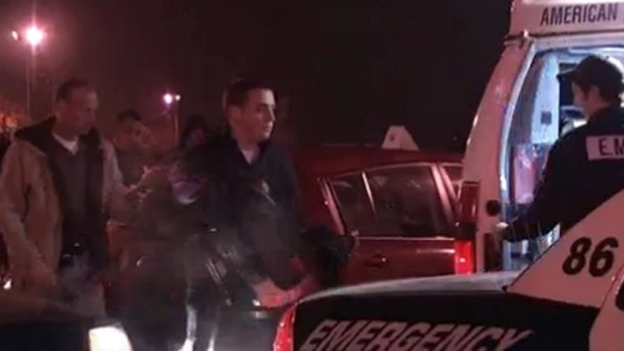 Police remove a 2-year-old child from a car in a K-Mart parking lot.