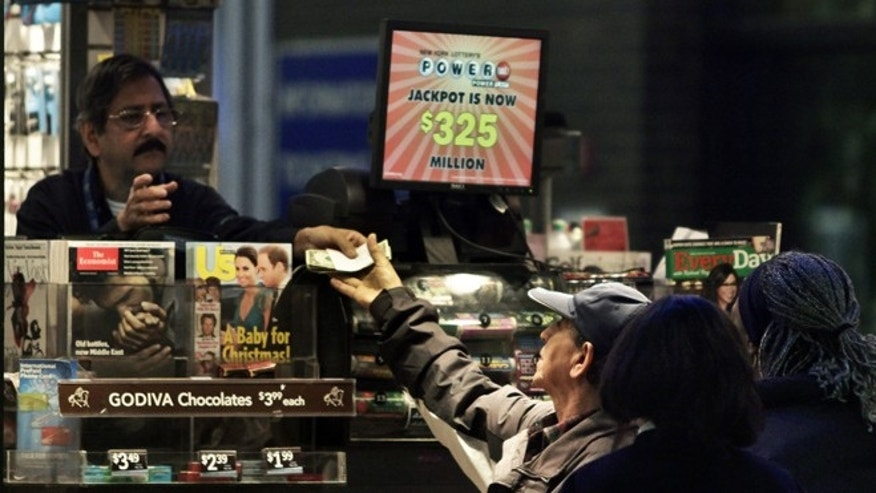 Nov. 23: A vendor, left, receives money for a lottery purchase in New York.