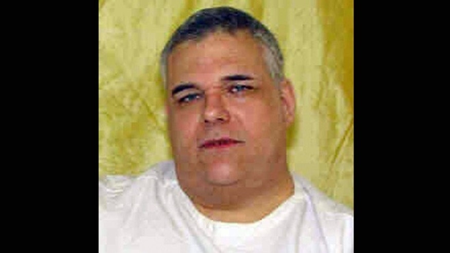 This undated photo provided by the Ohio Dept. of Rehabilitation and Corrections shows  death row inmate Ronald Post. Post, 53,  scheduled to die Jan. 16, 2013, for the 1983 shooting death of hotel desk clerk, wants his upcoming execution delayed. At 480 pounds, Post says hes too heavy for the states lethal injection process.