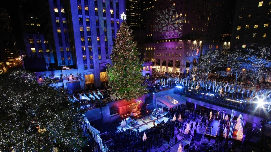 Nov. 28, 2012: Crowds gather as the Rockefeller Center Christmas Tree is lit during the 80th annual tree lighting ceremony at Rockefeller Center in New York.