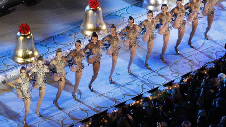 Nov. 28, 2012: The Radio City Music Hall Rockettes perform before the Rockefeller Center Christmas Tree is lit during the 80th annual tree lighting ceremony at Rockefeller Center in New York.