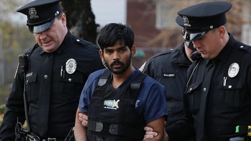 Nov. 28: Raghunandan Yandamuri is escorted to a Montgomery County district court for a preliminary hearing in Bridgeport, Pa.