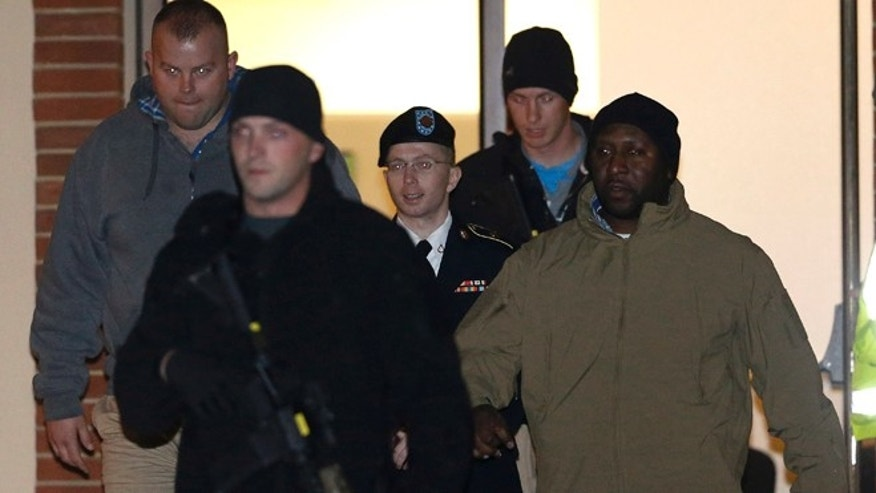 Nov. 27: Army Pfc. Bradley Manning, center, is heavily guarded as he is led out of a courthouse in Fort Meade, Md.