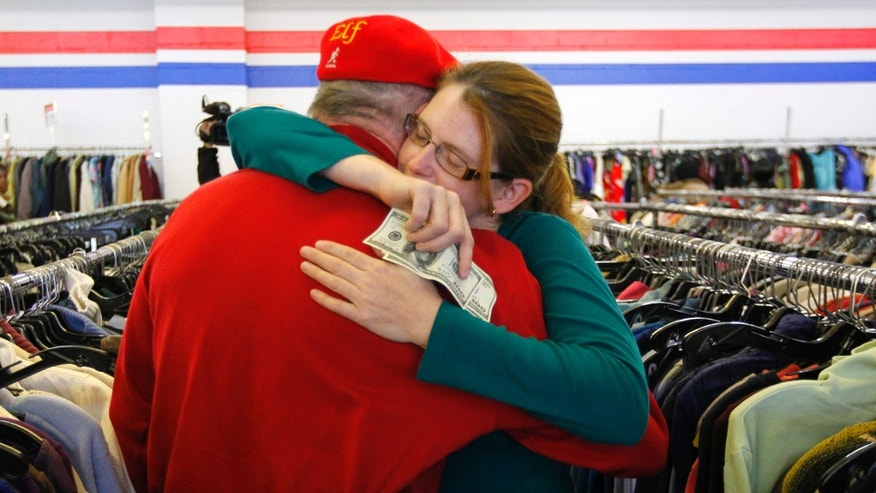 Nov. 29, 2012: Janice Kennedy hugs Secret Santa after getting a $100 dollar bill from the wealthy philanthropist from Kansas City, Mo. while looking for clothes at the Salvation Army store in the boro of Staten Island, New York, N.Y.