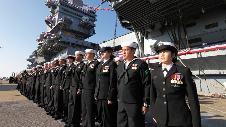 Dec. 1, 2012: The crew of the USS Enterprise stands at attention after disembarking the ship during the inactivation ceremony for the first nuclear powered aircraft carrier USS Enterprise at Naval Station Norfolk   in Norfolk, Va.