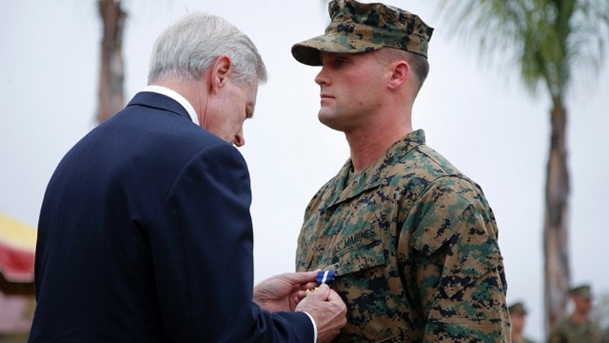 Dec. 3, 2012: U.S. Marine Sgt. William Soutra Jr., right, receives the Navy Cross from Secretary of the Navy Ray Mabus during a ceremony held at Camp Pendleton, Calif.