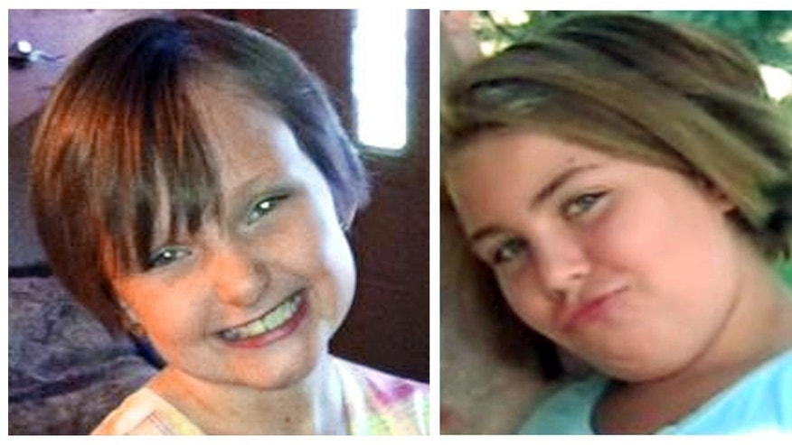 This combo made from undated photos provided by the FBI shows cousins Lyric Cook, 10, right, and Elizabeth Collins, 8, who have been missing since Friday, July 13, 2012.