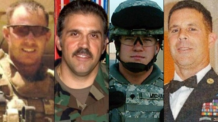Nov. 20: FILE From left: Sgt. Maj. Gary Stouffer, 37; Sgt. Maj. Lawrence Boivin, 47; Army Sgt. Joshua Michael, 34, and Sgt. Maj. William Lubbers, 43, four veterans killed when a parade float they were riding on was struck by a freight train at a crossing in Midland, Texas.