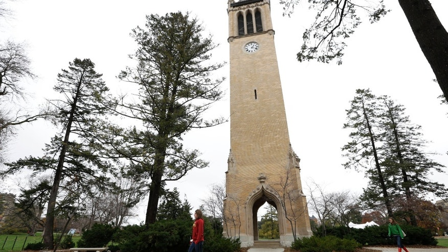 Dec. 12, 2012: In this file photo students walk past the Campanile on the Iowa State University campus in Ames, Iowa.
