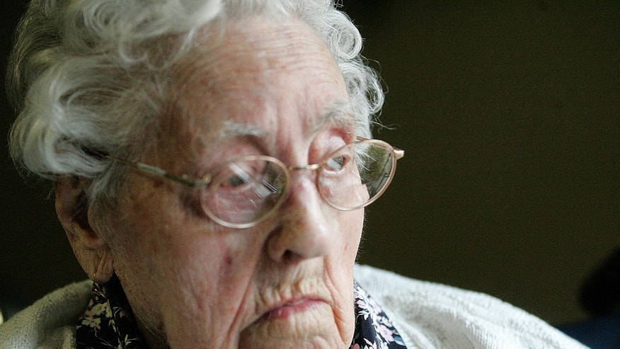 FILE - This file April 2010 photo shows Dina Manfredini of Johnston, Iowa. Manfredini, who inherited the title of world's oldest person less than two weeks ago, died Monday, Dec. 17, 2012, at age 115, her granddaughter Lori Logli said. She did not elaborate on the cause of her grandmother's death. Manfredini was born on April 4, 1897, in Italy, according to Guinness officials. She moved to the United States in 1920 and settled in Des Moines with her husband.  (AP Photo/The Des Moines Register, Lisa Fernandez)