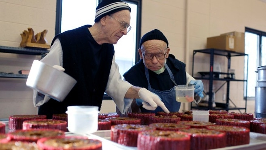 Nov. 30, 2012: Father Cyprian Harrison, left, and Brother Thomas Imhoff decorate fruitcakes at Assumption Abbey, in Ava, Mo.