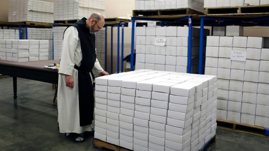 Nov. 29, 2012: Brother Francis Flaherty looks over boxes of fruitcakes ready to be shipped all over the world at Assumption Abbey in Ava, Mo.
