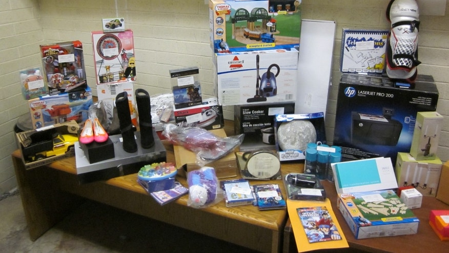 "Items allegedly stolen by a thief authorities have dubbed a ""grinch"" are shown."
