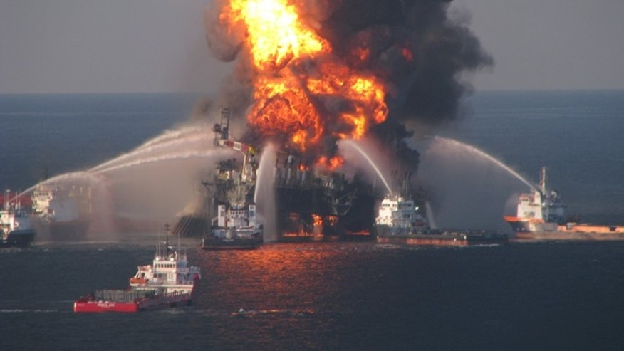 FILE 2010: Fire boat response crews battle the blazing remnants of the off shore oil rig Deepwater Horizon.
