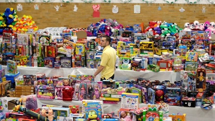 Dec. 21, 2012: Volunteer Anthony Vessicchio of East Haven, Conn., helps to sort tables full of donated toys at the town hall in Newtown, Conn.