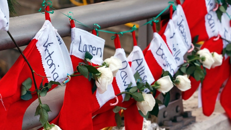 Dec. 19, 2012 - Christmas stockings with the names of shooting victims hang from railing near a makeshift memorial near the town Christmas tree in the Sandy Hook village of Newtown, Connecticut