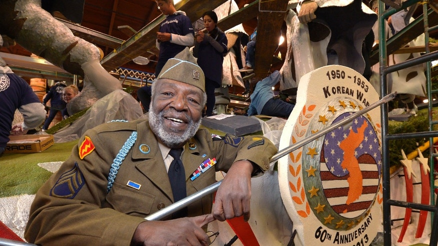 "Dec. 29, 2012: Korean War veteran James McEachin, 82,  poses in front of the Rose Parade float ""Freedom Is Not Free"" by the Korean War Commemoration Committee in Pasadena, Calif."