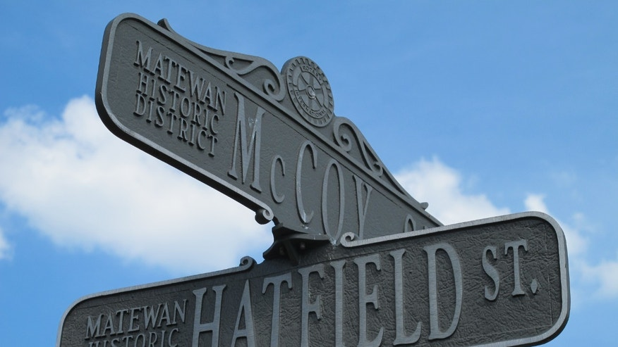 June 9, 2012: A street sign in Matewan, W.Va., bears the names of the two families that once waged the country's most famous feud in this Appalachian region.