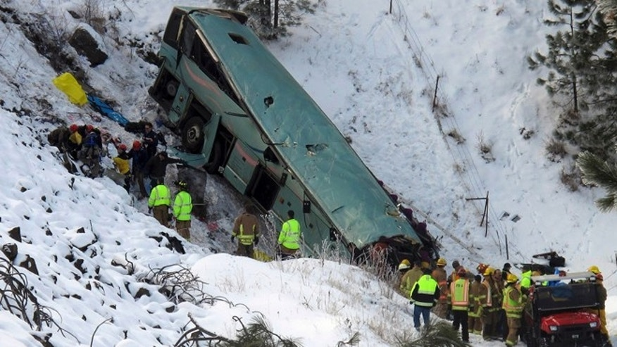 Dec. 30, 2012: Emergency personnel respond to the scene of a multiple-fatality accident after a tour bus careened through a guardrail along an icy highway and fell several hundred feet down a steep embankment, authorities said, about 15 miles east of Pendleton, Ore.