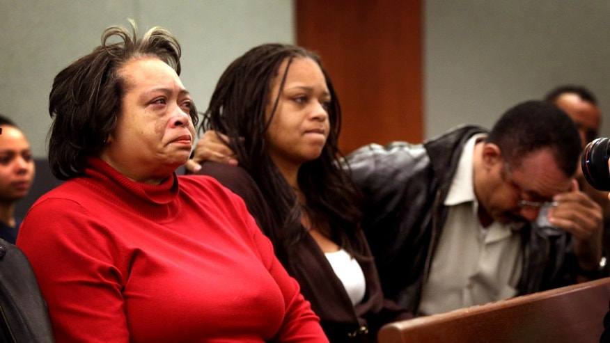 Claudette Flanagan-Jones, left, Jade Morris' grandmother, Tejuana Reeves-Morris, Jade's mother, and Andres Mack, Jade's grandfather, sit while Brenda Stokes Wilson appears at Clark County Justice Court, Friday, Dec. 28, 2012, in Las Vegas. Wilson is accused of slashing a Bellagio blackjack dealer and is suspected of kidnapping and slaying 10-year-old Jade Morris. A judge raised bail for Wilson from $60,000 to $600,000 on Friday in light of expected murder charges to be filed Friday afternoon. (AP Photo/Las Vegas Review-Journal, Jeff Scheid) LOCAL TV OUT; LOCAL INTERNET OUT; LAS VEGAS SUN OUT