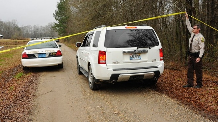 Jan. 2, 2013: A Walker County sheriff's deputy lifts crime scene tape for investigators as National Transportation Safety Board officials continue investigate the fatal crash Tuesday night of a small plane that was reported stolen near Jasper, Ala.