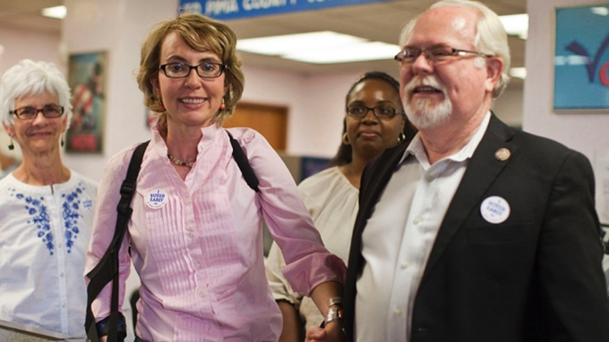Nov. 5, 2012: Former congresswoman Gabrielle Giffords and Congressman Ron Barber leave the Pima County Recorder&#39&#x3b;s office.