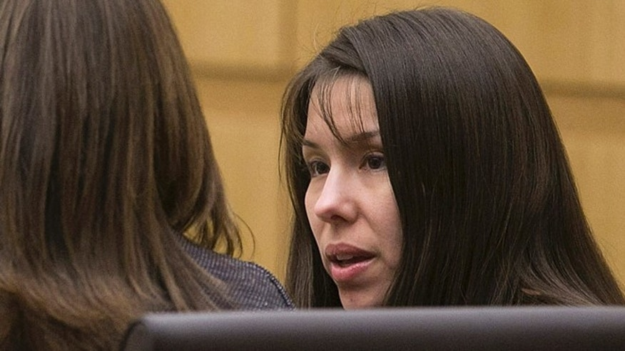 Jan. 2, 2013: Defendant Jodi Arias talks with her defense team during the prosecution's opening statements in the trial of Arias in Maricopa County court in Phoenix. (AP/The Arizona Republic)