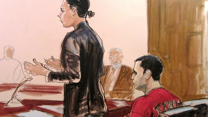 Oct. 25, 2012: In this courtroom drawing, federal defender Julie Gatto requests bail for her client, New York City Police Officer Gilberto Valle, right, at Manhattan Federal Court in New York. (AP)