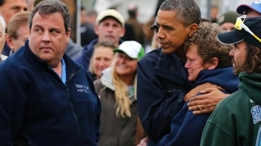 Oct. 31, 2012: President Obama hugs North Point Marina owner Donna Vanzant as he tours damage done by Hurricane Sandy in Brigantine, N.J.