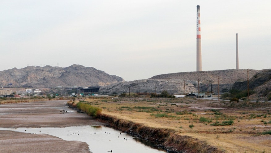 Nov. 28, 2012: This photo shows ASARCO copper smelter smokestacks near the Rio Grande in El Paso, Texas.