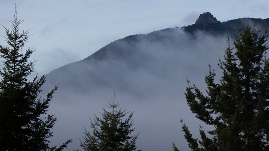Jan. 4, 2013: Rugged terrain surrounds the summit of Mount Si, upper right, near North Bend, Wash.