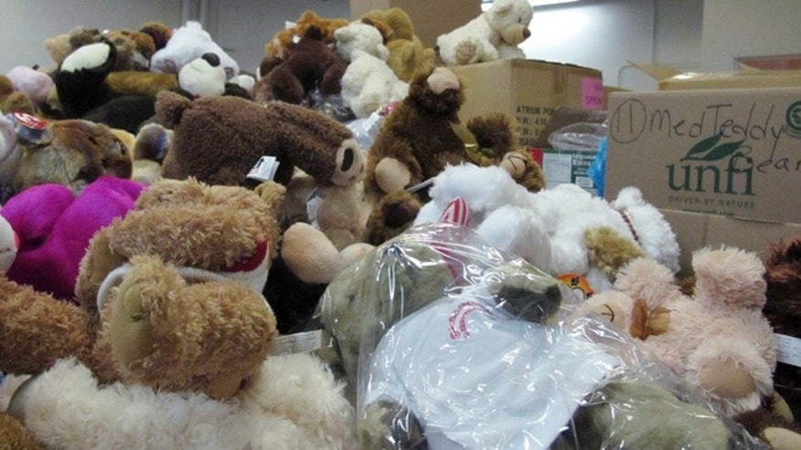 Dec. 31, 2012: In this file photo, piles of donated stuffed animals await sorting in a warehouse in Newtown, Conn.