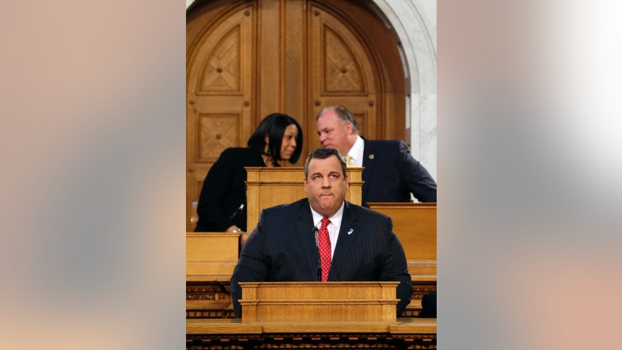 New Jersey Senate President Stephen M. Sweeney, right, D-Thorofare,N.J., and Assembly Speaker Sheila Y. Oliver, left, D-East Orange, N.J., talk as Gov. Chris Christie pauses while delivering his State Of The State address at the Statehouse, Tuesday, Jan. 8, 2013, in Trenton, N.J.  (AP Photo/Mel Evans)