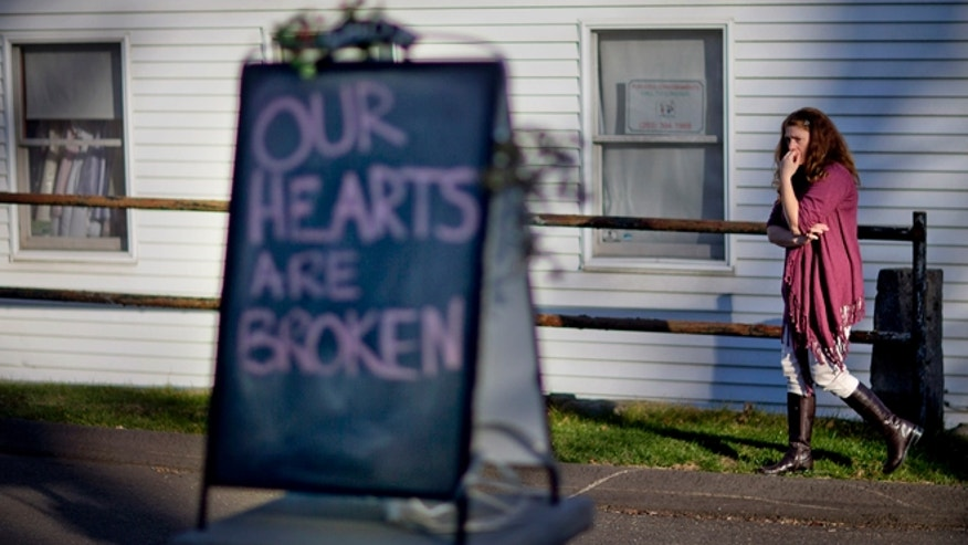 Dec. 15: Tamara Doherty paces outside her store just down the road from Sandy Hook Elementary School.